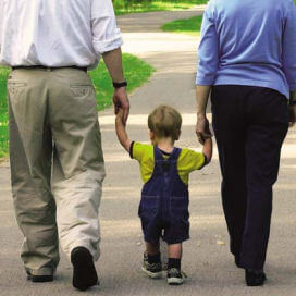 parents_walking_child - Adoption
