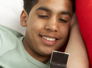 Young Boy Reading Text Message