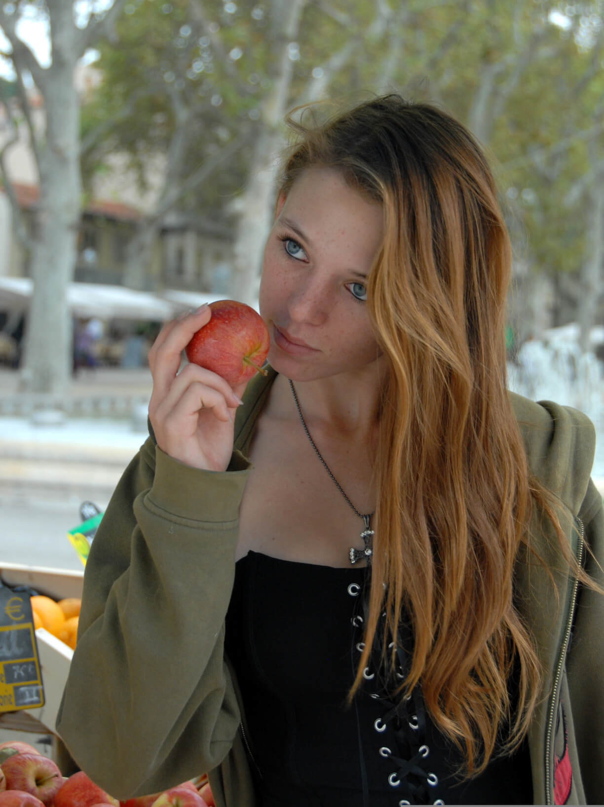 teenager and red apple