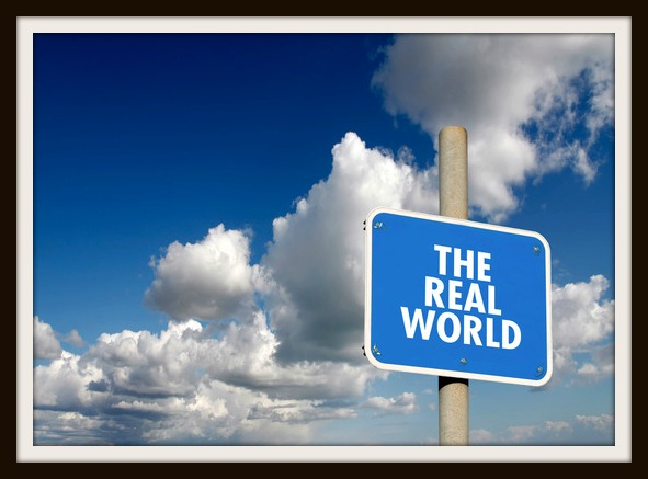 The real world signpost with blue sky and clouds