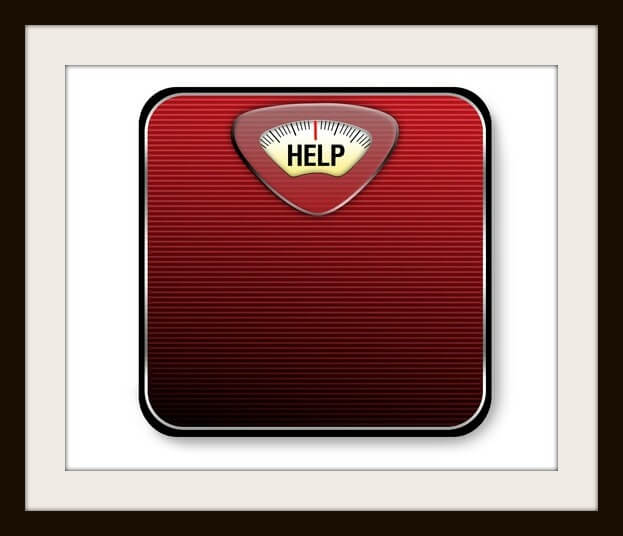 "A red and black scale with the word ""help"" for the weight display."