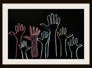 photodune-2630789-happy-volunteering-hands-on-a-blackboard-background-in-colorful-chalk-xs.jpg