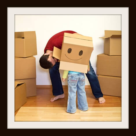 Father and little girl playing with lots of cardboard boxes - moving concept