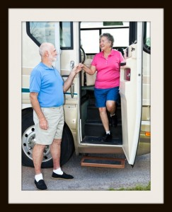 Polite senior man helps his wife down the stairs of their motor home.