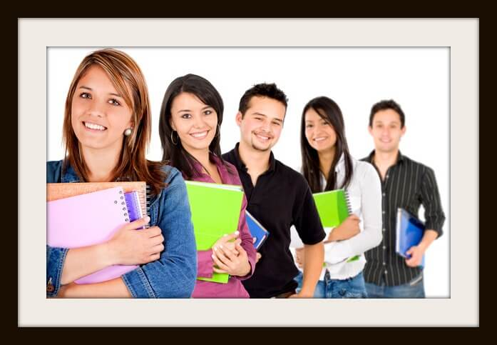 Casual group of college students smiling - isolated over a white background