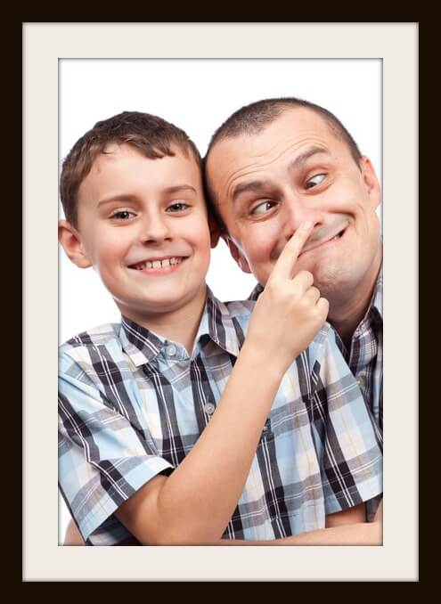 Cute kid and his dad making funny faces, isolated on white background