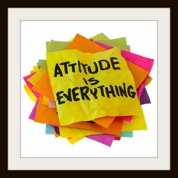 motivational slogan on a stack of colorful reminder notes isolated on white