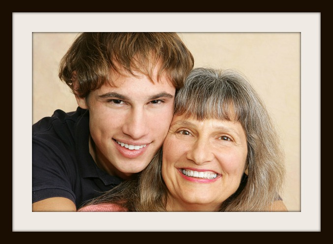 Closeup portrait of a mother and her young adult/late teen son.