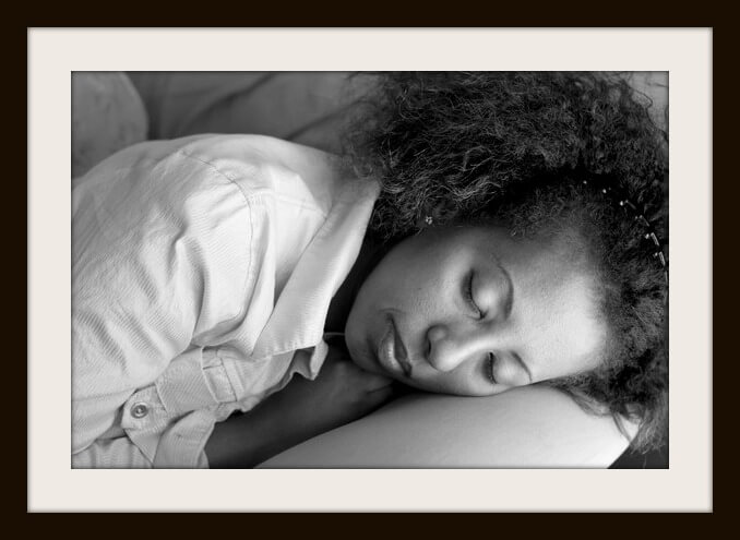 An Ethiopan woman taking a quick afternoon nap on the sofa