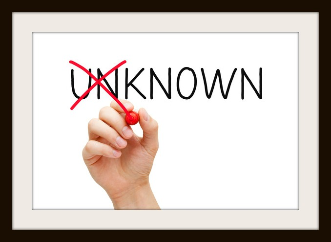 Hand turning the word Unknown into Known with red marker isolated on white.