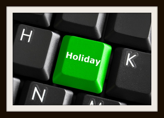 holiday concept with green button on computer keyboard