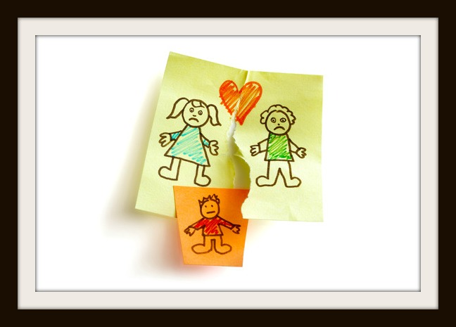 Unhappy family and child custody battle concept sketched on sticky note paper