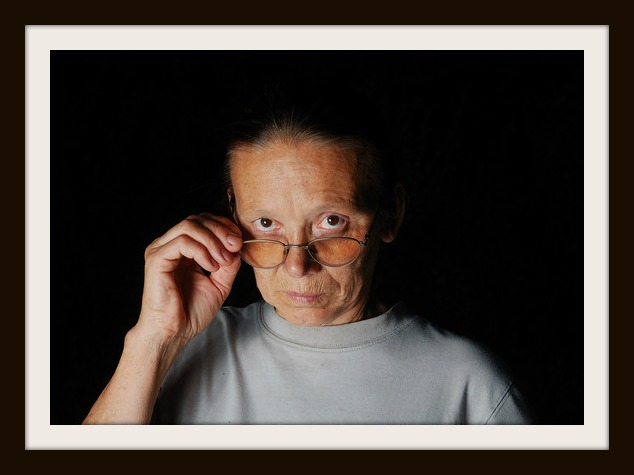 photodune-4695240-middle-aged-woman-with-glasses-with-dark-background-xs