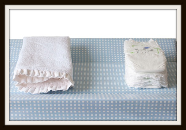 Changing table with diapers and towel for baby care