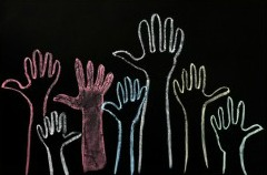 photodune-2630789-happy-volunteering-hands-on-a-blackboard-background-in-colorful-chalk-xs.jpg-300x218
