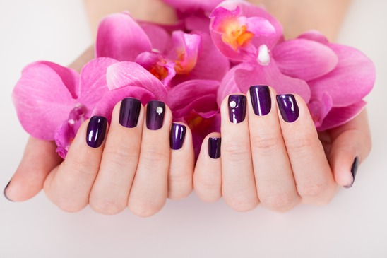 Woman with beautifully manicured nails