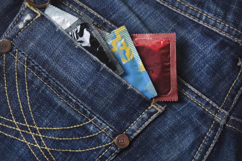 four condoms in the blue jeans pocket