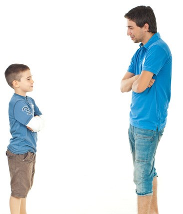 Father and son standing face to face and having conversation isolated on white background