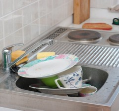 A pile of dirty dishes in the dishwasher