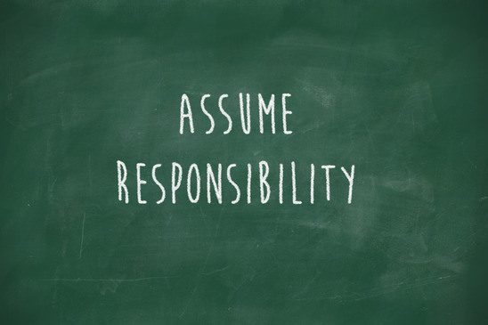 Assume responsibility handwritten on school blackboard