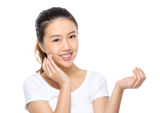 Woman apply skincare on face